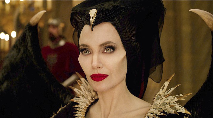 "This image released by Disney shows Angelina Jolie as Maleficent in a scene from ""Maleficent: Mistress of Evil."" (Disney via AP)"