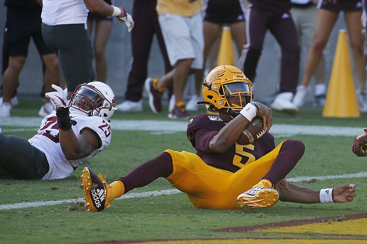 Arizona State quarterback Jayden Daniels (5) scores a touchdown as he eludes Washington State safety Skyler Thomas (25) during the second half of a game Saturday, Oct. 12, 2019, in Tempe. (Ross D. Franklin/AP)