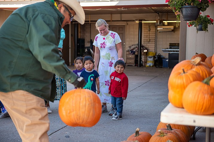 Eight of 27 children in the care of Hogan Hozhoni in Saint Michaels, Arizona stand outside the children's home as Speaker Seth Damon and staff unload pumpkins Oct. 7. (Photo/Office of Speaker)
