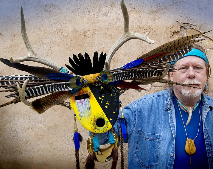 Robert Crying Red Bear with one of his mask creations at the Red Rock Native Art Guild. (Todd Roth/NHO)