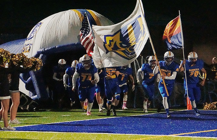 Prescott football exits their tunnel and storm the field before a game against Bradshaw Mountain on Friday, Oct. 11, 2019, at Bill Shepard Field in Prescott. (Aaron Valdez/Courier, File)