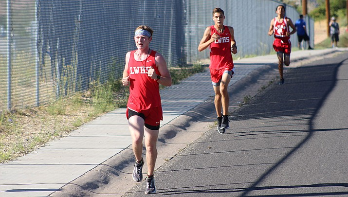 Lee Williams junior Cade Cantrell, left, took fourth, while teammate Hunter Serrano was 12 on Wednesday at Running the River. (Daily Miner file photo)