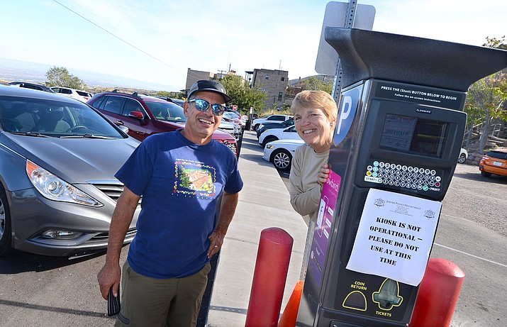 """Joan Reidy, and Gary Jenson, members of the Cleveland Hiking Club, pose with one of the new Jerome kiosks Wednesday, the first day the new kiosks were activated in town. However, a """"bug"""" in the software gave them free parking Wednesday afternoon. VVN/Vyto Starinskas"""
