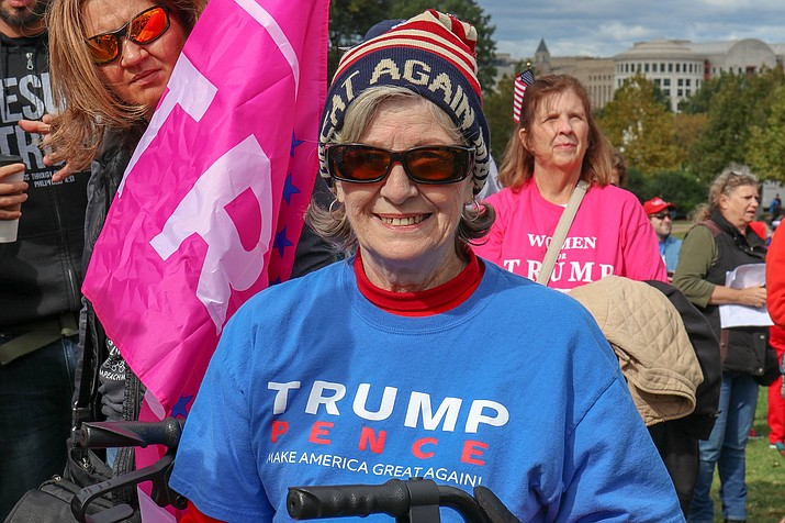 Gila Bend resident Diane Van Zwieten delayed her trip home from a summer in Ohio, in order to attend the March for Trump in Washington, D.C. this week. Arizonans protesting the impeachment process say keeping Trump in office will stop the U.S. from sliding into communism. (Photo by Megan U. Boyanton/Cronkite News)
