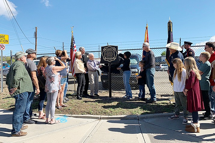 During a late-September ceremony, family members and friends of the 19 fallen Granite Mountain Hotshots unveil a plaque commemorating the site of Fire Station 7 – the last headquarters of the Hotshots before 19 of the crew members died fighting the Yarnell Hill Fire in June 2013. (City of Prescott/Courtesy)