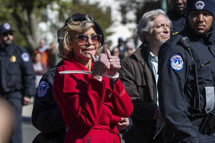 Actress Jane Fonda gestures after being arrested during a rally on Capitol Hill in Washington, Friday, Oct. 18, 2019. A half-century after throwing her attention-getting celebrity status into Vietnam War protests, Fonda is now doing the same in a U.S. climate movement where the average age is 18. (Manuel Balce Ceneta/AP)
