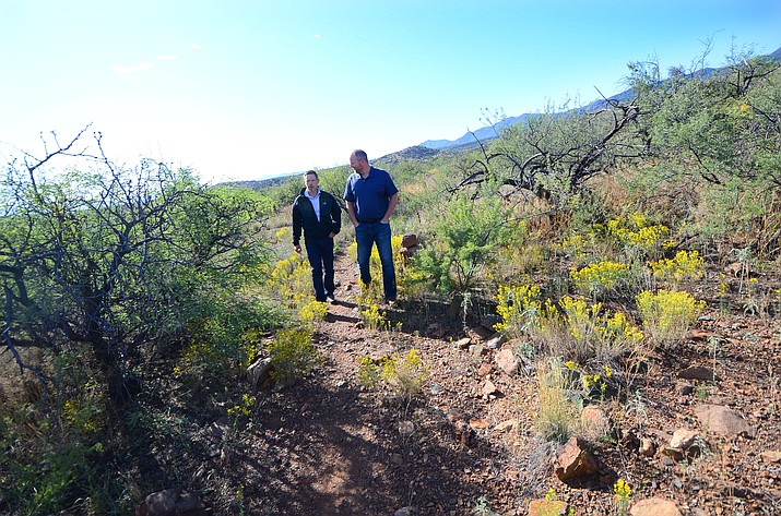 Verde Valley Campus Dean James Perey, left, and Cottonwood Parks & Recreation Supervisor Hezekiah Allen take a walk on the campus trails at Yavapai College. The trails will be reconstructed to Forest Service standards in the weeks ahead by Prescott National Forest work crews. VVN/Vyto Starinskas