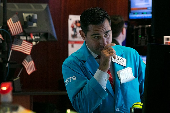 In this Oct. 2, 2019, file photo specialist William Geier works on the floor of the New York Stock Exchange. (Richard Drew/AP)