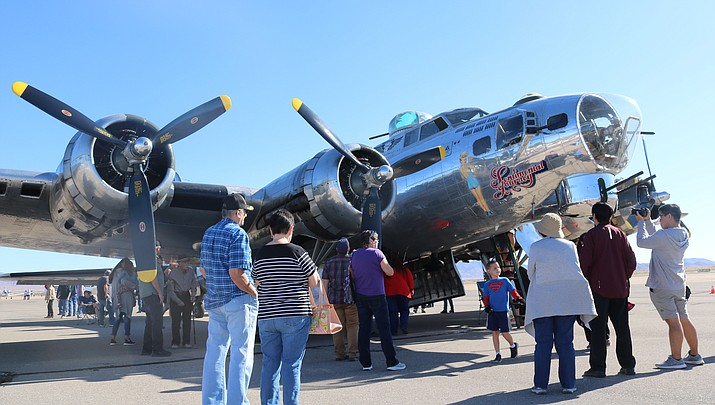 A crowd gathers around a World War II-era B-17 bomber during the AirFest on Saturday at the Kingman Municipal Airport. (Photo by Travis Rains/Daily Miner)