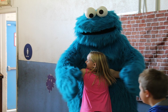 Sesame Street's Cookie Monster delighted Kingman children, Saturday, at The Club for YOUth.