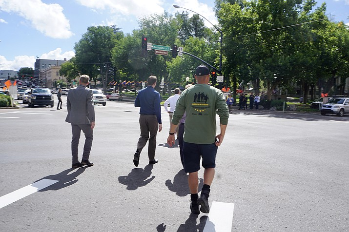 City officials and local residents take the initial diagonal walk across the intersection at Gurley and Montezuma streets during the Sept. 10 launch of the 'pedestrian scramble' configuration. The Prescott City Council is scheduled to hear a presentation on the test period for the scramble during its study session at 1 p.m. Tuesday, Oct. 22. (Cindy Barks/Courier, file)