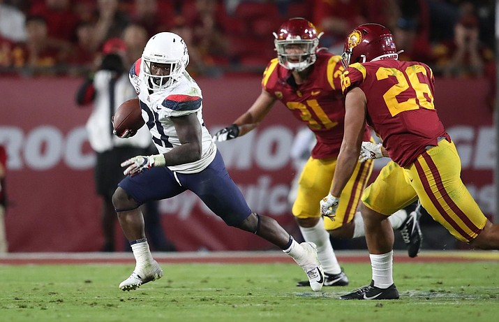 Arizona's J.J. Taylor runs for positive yardage during the Wildcats 41-14 loss to USC on Saturday. (Univeristy of Arizona Athletics photo)