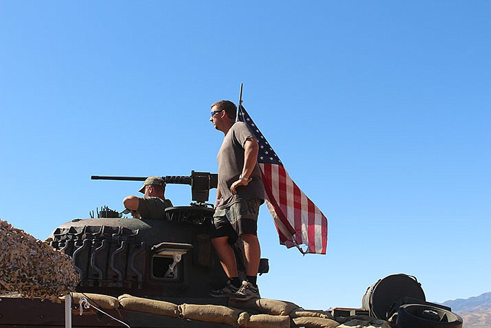 Scott Rickard is shown in the turret of his M4 Sherman tank at the Big Sandy Shoot near Wikieup on Saturday, Oct. 19.