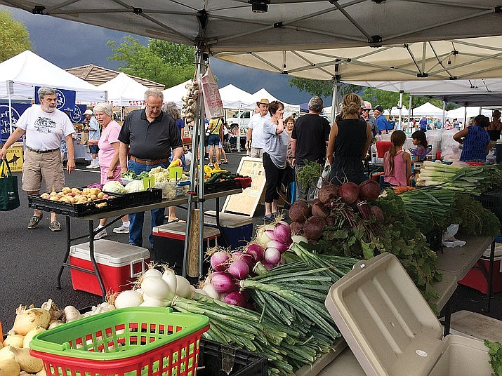 The Prescott Valley Farmers Market is hosting a Harvest Fest from 9 a.m. to 1 p.m. Sunday, Oct. 27 in the Entertainment District near the Harkins Theater. Shown are customers at the market in 2018 (Courier/File)