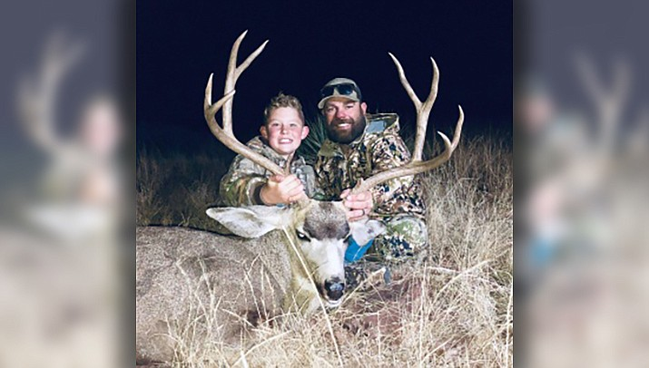 Slade Van Vleet, 12, is shown with his father, Clint Van Vleet, after a successful deer hunt. (Courtesy photo)