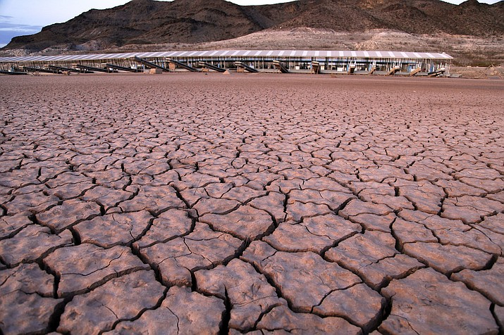 n this July 16, 2014 file photo, what was once a marina sits high and dry due to Lake Mead receding in the Lake Mead National Recreation Area in Arizona. Several states that rely on a major Western river are pushing for federal legislation to implement a plan to keep key reservoirs from shrinking amid a prolonged drought. The Colorado River serves 40 million people in Arizona, California, Colorado, Nevada, New Mexico, Utah and Wyoming. Representatives from those states are meeting Tuesday, March 19, 2019, to sign a letter to Congress asking for support for so-called drought contingency plans. (AP Photo/John Locher, File)