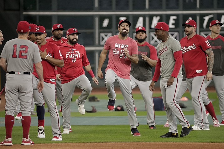 Washington Nationals third baseman Anthony Rendon, middle, warms up during batting practice for baseball's World Series Monday, Oct. 21, 2019, in Houston. The Houston Astros face the Washington Nationals in Game 1 on Tuesday. (David J. Phillip/AP)