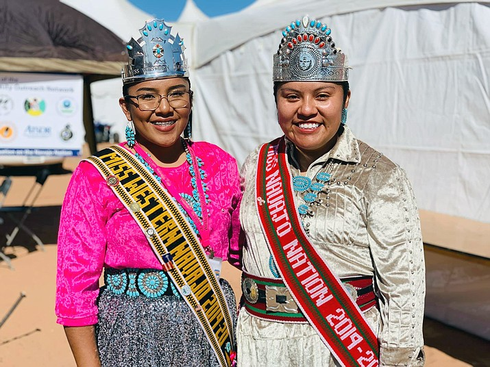 Newly crowned Miss Western Navajo 2019-2020, Maegan Dougi, makes her way around the fairgrounds visiting people during the Western Navajo Fair Oct. 11, in Tuba City, Arizona. Miss Western Navajo Maegan Dougi (left) and Miss Navajo Nation Shaandiin P. Parrish (right) of Kayenta, Arizona visit. (Photo/Navajo Nation Office of the President/VP)