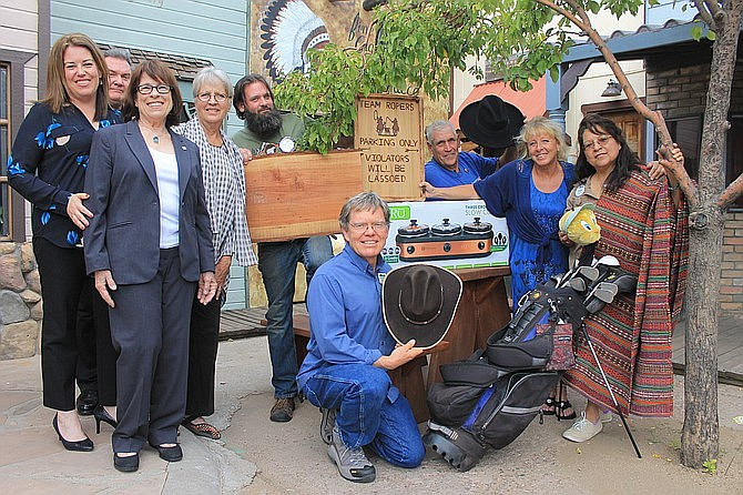 Rotarians gather to show various auction items during their 2017 Western Auction. This year's auction will be held Oct. 26 at the Williams Rodeo Barn. (Wendy Howell/WGCN)