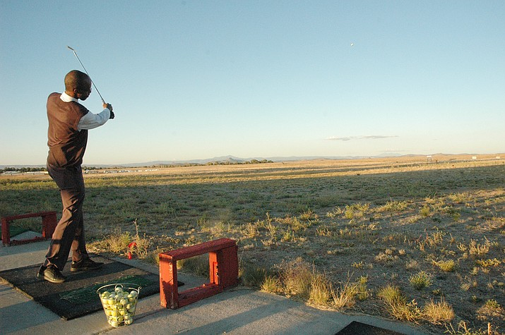 Clent Walker, general manager and managing funeral director at Heritage Memory Mortuary and Chino Valley Funeral, drives a golf ball during the Chino Valley Chamber of Commerce's Men in Business Mixer at Chino Valley Golf Range Thursday, Oct. 17, 2019. Participants were aiming for pumpkin targets. Chamber of Commerce Executive Director Lorette Brashear said the next quarter's Men in Business Mixer will involve golf cart races. (Jason Wheeler/Review)