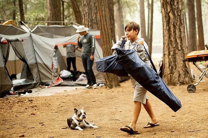 River Martinez, 10, breaks camp at the Upper Pines Campground in Yosemite National Park, Calif. The Interior Department is considering recommendations to modernize campgrounds within the National Park Service. (AP Photo/Noah Berger, File)