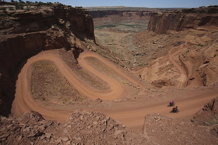 Mountain bikers near the end of a 75-mile trip as they climb Mineral Bottom Road after riding the White Rim Trail in Canyonlands National Park. Street legal off-road vehicles would be allowed on this and other roads in Utah's five national parks under a directive issued by the National Park Service's regional office. (Francisco Kjolseth/The Salt Lake Tribune via AP)