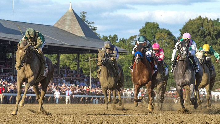 Code of Honor, left, with jockey John Velazquez, leads the field to the finish line to win the Travers Stakes horse race at Saratoga Race Course in Saratoga Springs, N.Y. The Breeders' Cup Classic pits West Coast star McKinzie against Code of Honor, the East's top horse who finished second in the Kentucky Derby. (Photo courtesy of Skip Dickstein/The Albany Times Union)