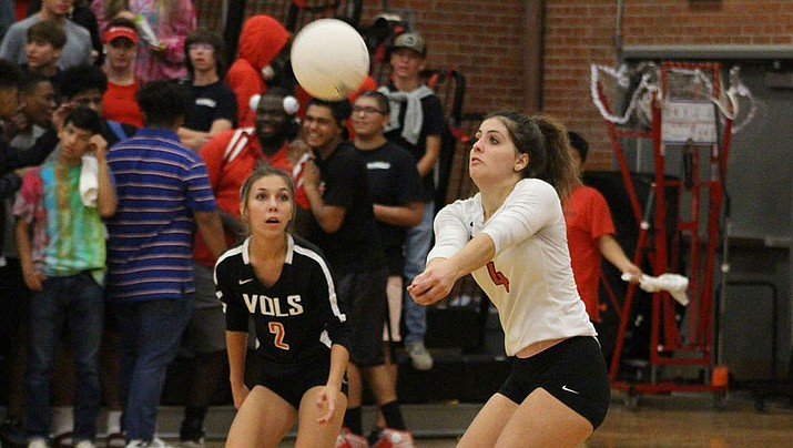 Lee Williams senior Lorelei Fernandez makes a pass Tuesday night as Natalie Sanchez watches during a 3-0 loss to Estrella Foothills. (Photo by Beau Bearden/Daily Miner)