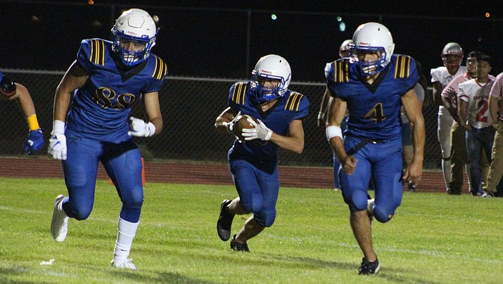 From left, Joey Drumright, Gavin Randall and Austin Dias will play their final high school football game Friday night at Wickenburg. (Daily Miner file photo)
