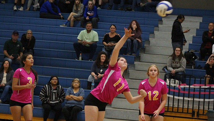 Kingman senior Morgan Stephens sends the ball over the net Thursday as Aleah Meza, left, and Haden Gesser look on during a 3-1 setback to Chino Valley. (Photo by Beau Bearden/Daily Miner)