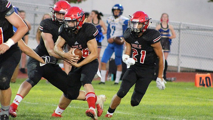 Lee Williams seniors Wesley Boyd, ball carrier, and Donnie Simms (21) have rushed for a combined 898 yards and five touchdowns this season. (Daily Miner file photo)