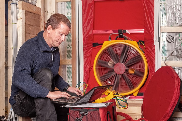 A blower door test is a way to check how airtight a structure is. It is designed to check for air leaks in walls, attics  and mechanical penetrations. (Courier stock image)