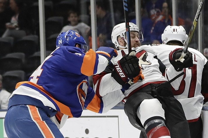 New York Islanders' Scott Mayfield (24) checks Arizona Coyotes' Derek Stepan (21) during the first period of an NHL hockey game Thursday, Oct. 24, 2019, in Uniondale, N.Y. (Frank Franklin II/AP)