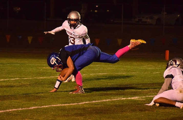 Camp Verde sophomore Jacob Oothoudt stays up to add yardage to a long run during the Cowboys' 56-48 loss to Trivium Prep at home on Friday night. VVN/James Kelley