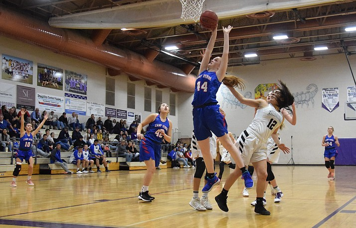 Camp Verde's Shelly Warfield grabs a rebound at Sedona Red Rock. The Cowboys hope to still play the Scorpions even though they moved to 3A and Sedona Red Rock remained in 2A. VVN/James Kelley