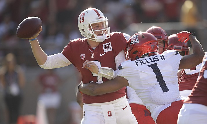 Stanford quarterback K.J. Costello, left, is pressured by Arizona's Tony Fields II (1) during the second half of a game Saturday, Oct. 26, 2019, in Stanford, Calif. (Ben Margot/AP)