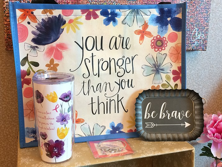 The BreastCare Center Gift Shop offers a line of items with positive and supporting words for women undergoing treatment or who have survived breast cancer. A lending library is located in the same alcove in the foyer. (Courier)