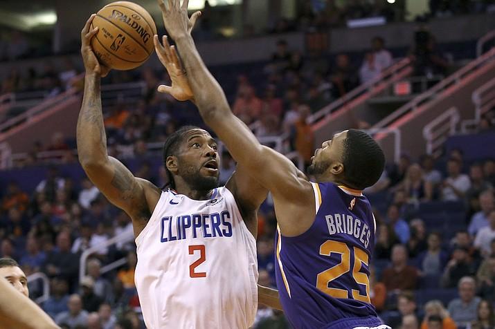 LA Clippers forward Kawhi Leonard (2) shoots over Phoenix Suns forward Mikal Bridges (25) during the first half of a game Saturday, Oct. 26, 2019, in Phoenix. (Ross D. Franklin/AP)