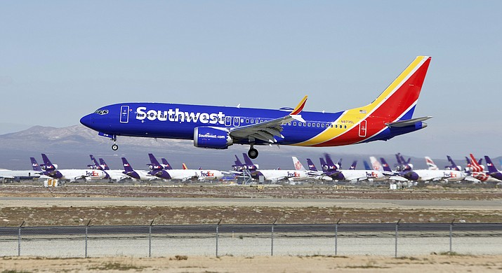 In this March 23, 2019, file photo, a Southwest Airlines Boeing 737 Max aircraft lands at the Southern California Logistics Airport in the high desert town of Victorville, Calif. A lawsuit filed against Southwest Airlines by a flight attendant alleges pilots on a 2017 flight had an iPad streaming video from a hidden camera in a bathroom in one of the airline's jets. Court filings by attorneys for Dallas-based Southwest and the two pilots denied the livestreaming allegations, and Southwest issued a brief statement Saturday, Oct. 26, saying it would not comment in detail on the suit but denied placing cameras in the lavatories in aircraft. (AP Photo/Matt Hartman, File)