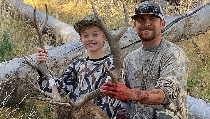 Hunter Asplin and his father Roger show off the 5x5 bull elk that Hunter harvested this year. (Courtesy photo)