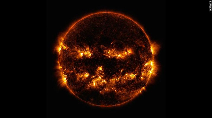 Active regions on the Sun created this jack-o'-lantern face, as seen in ultraviolet light by NASA's Solar Dynamics Observatory satellite. (Photo/NASA)