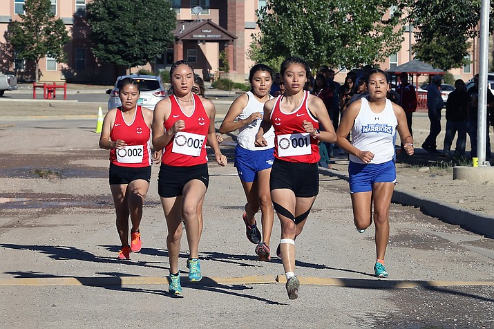 Freshmen runners Shaylese Tsabetsaye (front left) and Shada Golden (front right) jump out to an early lead of the 2019 Skyhawk Invitational. Golden finished first in 3K race with a time of 15:33. Tsabetsaye followed three seconds later. (Photo/Navajo Technical University)