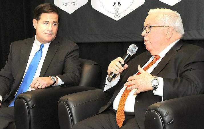 Gov. Doug Ducey, shown here in a file photo listening to Assistant Commerce Secretary Tom Gilman, pointed out Wednesday that there has been no such recommendation, either from the U.S. Centers for Disease Control and Prevention or his own Department of Health Services. Instead, he said, they have simply recommended that there not be gatherings of more than 10 people. (Capitol Media Services photo by Howard Fischer)