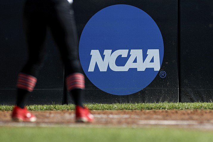 A detail view of the NCAA logo is seen as a Lamar University softball player's cleats are seen in the batter's box during an Northwestern State University at Lamar University NCAA softball game on Friday, April 19, 2019 in Beaumont, Texas. (Aaron M. Sprecher/AP)