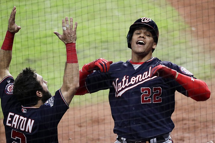 Washington Nationals' Juan Soto (22) celebrates after his home run with Adam Eaton during the fifth inning of Game 6 of the World Series against the Houston Astros Tuesday, Oct. 29, 2019, in Houston. (Sue Ogrocki/AP)