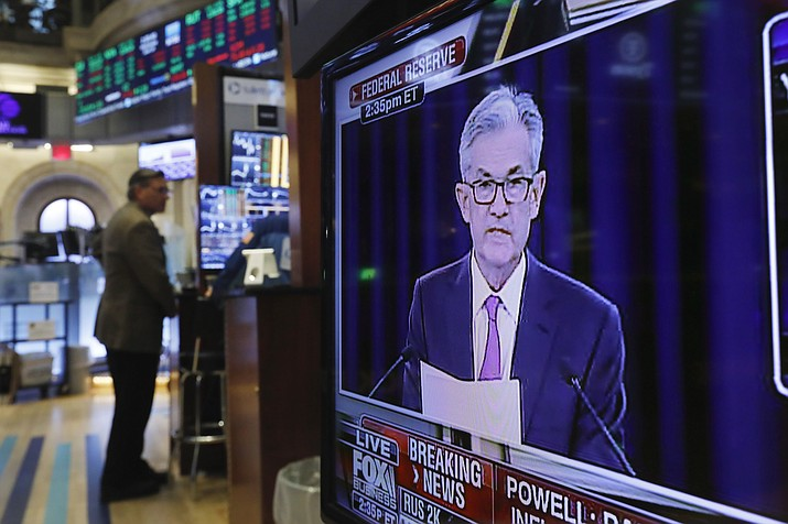 In this June 19, 2019, file photo the Washington news conference of Federal Reserve Chair Jerome Powell appears on television screen on the trading floor of the New York Stock Exchange shows the rate decision of the Federal Reserve. The Fed concludes its two-day meeting Wednesday, Oct. 30. (Richard Drew/AP, File)