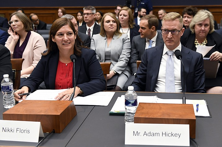 In this Oct. 22, 2019, file photo, Deputy Assistant Director for Counterterrorism at the FBI Nikki Flores, left, and Deputy Assistant Attorney General for National Security Adam Hickey, right, wait to testify before the House Judiciary Committee hearing on Capitol Hill in Washington, on election security. Russia interfered in the 2016 election and may try to sway next year's vote as well. But it's not the only nation with an eye on U.S. politics. American officials sounding the alarm about efforts to disrupt the 2020 election include multiple countries in that warning. (Susan Walsh/AP)