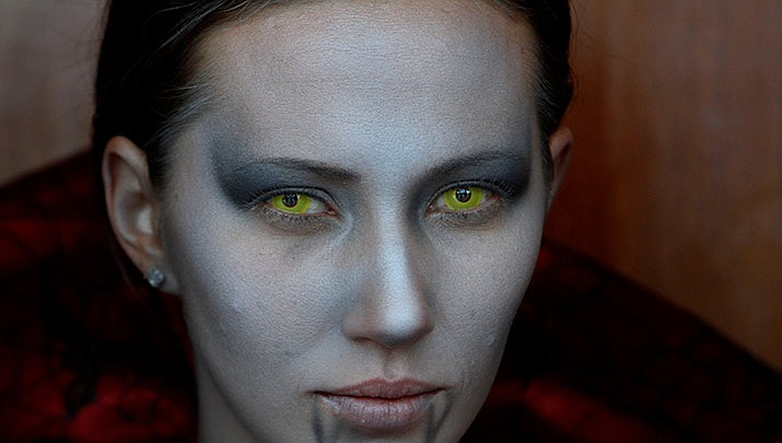 Your appearance won't be the only frightening thing about wearing costume contact lenses this Halloween. Your eyes might look like a lizard's for an evening, but the risk of permanent vision loss may not be worth the temporary thrill. (AP Photo/Emilio Morenatti)
