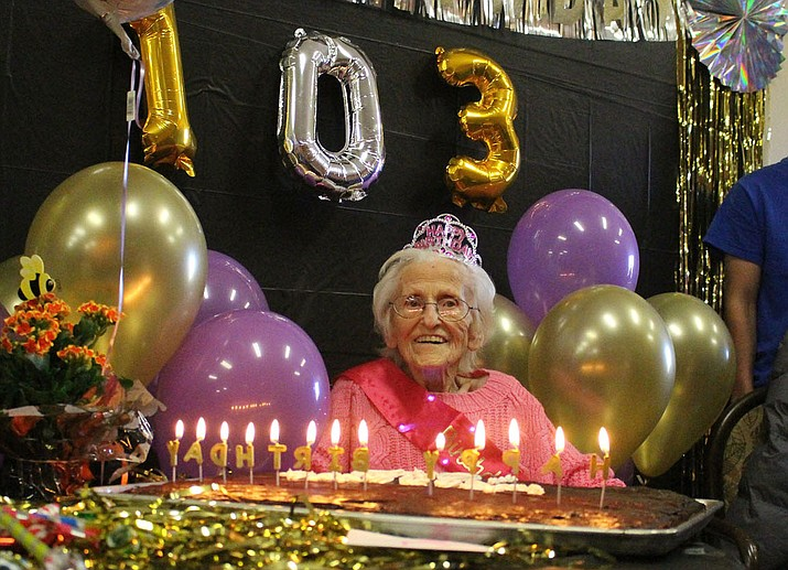 """Jeanette"" Jakubowski puts on a smile Wednesday afternoon during her 103rd birthday celebration at the Lingenfelter Center. (Photo by Beau Bearden/Daily Miner)"