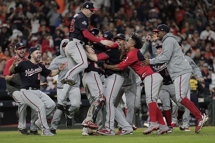 The Washington Nationals celebrate after Game 7 of the baseball World Series against the Houston Astros Wednesday, Oct. 30, 2019, in Houston. The Nationals won 6-2 to win the series. (David J. Phillip/AP)